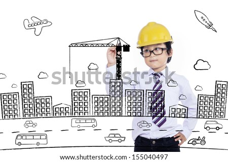 Little boy drawing a building on transparent board - stock photo
