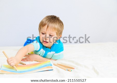little boy drawing, education and daycare concepts - stock photo