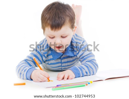 Little boy drawing with color pencils - stock photo