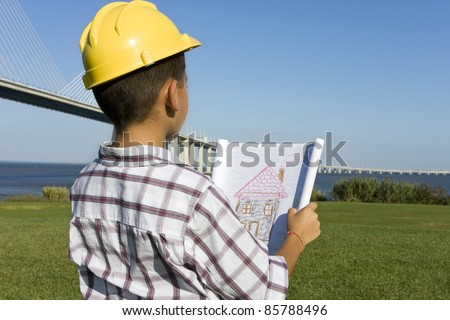 Little boy dreaming about a new home - stock photo