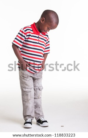 Little boy dressed in stripes and denim for a photographic shoot in the studio. - stock photo