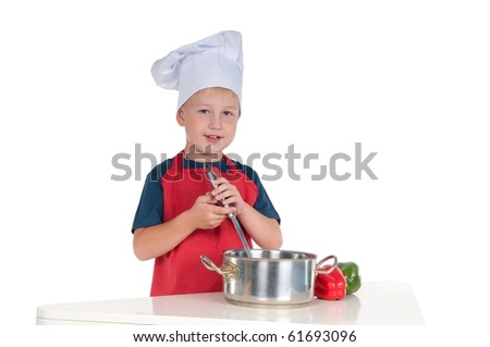 Little boy dressed like a chef making diner isolated on white background - stock photo