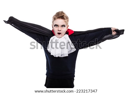 Little boy dressed up as Dracula for the halloween party. Studio portrait isolated over white background   - stock photo