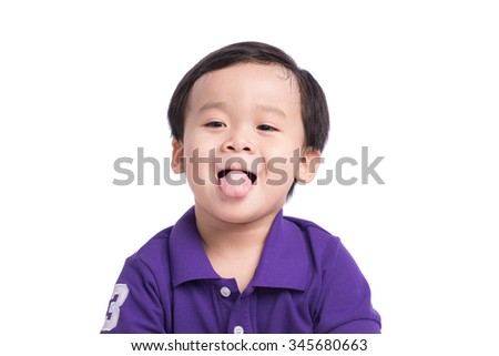 Little boy drinking milk. Cheeky kid making funny expressions - stock photo