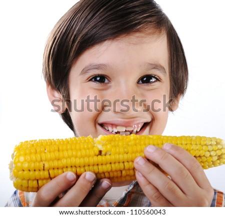 Little boy eating corn - stock photo