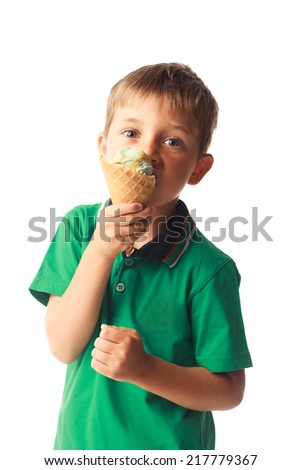 Little boy eating ice cream isolated on white background - stock photo