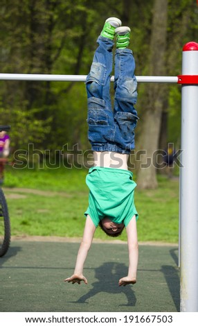 little boy engaged in athletics for sports equipment - stock photo