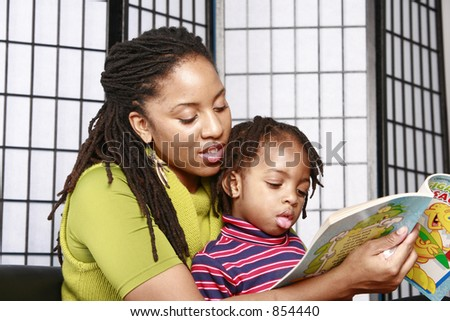 Little boy enjoying story time - stock photo