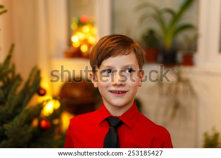 Little boy excited at Christmas, indoor portrait - stock photo