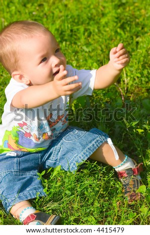 Little boy extend hands - stock photo