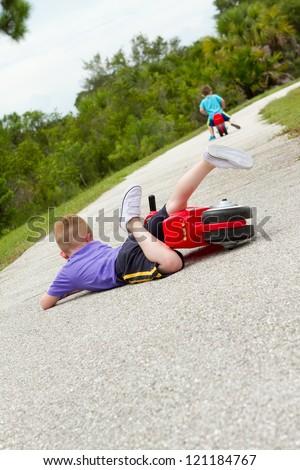 little boy fallen off of his bike - stock photo