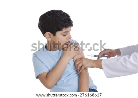 Little boy getting an injection - stock photo