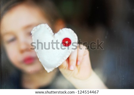 little boy gives a heart - stock photo