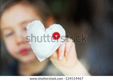 little boy gives a heart - stock photo