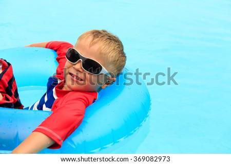 little boy having fun in swimming pool - stock photo