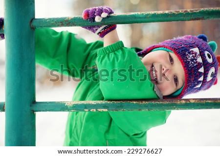 Little boy having fun in winter - stock photo