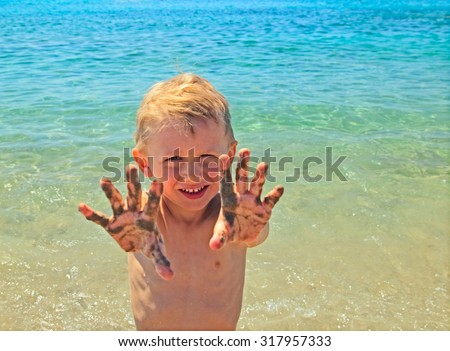 little boy having fun on beach - stock photo