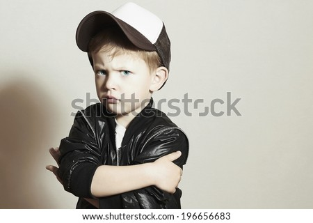 little boy.Hip-Hop Style. fashion children.handsome.in Tracker Hat. Young Rapper. Serious Child in Cap. 4 years old - stock photo