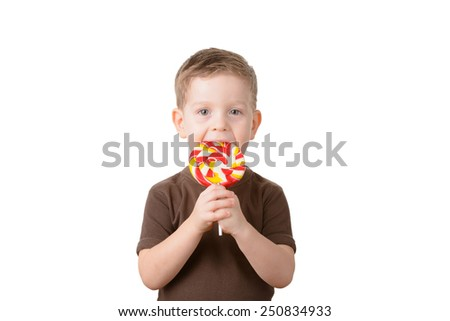 little boy holding a lollipop on a white background - stock photo