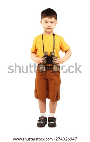 Little boy holding a pair of binoculars isolated on white background - stock photo