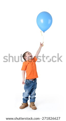 Little boy holding blue balloon on white background - stock photo