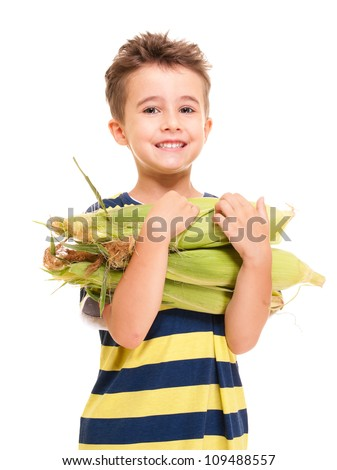 Little boy holding corn on the cob isolated on white - stock photo