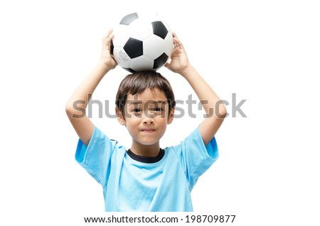 Little boy holding football on white background - stock photo