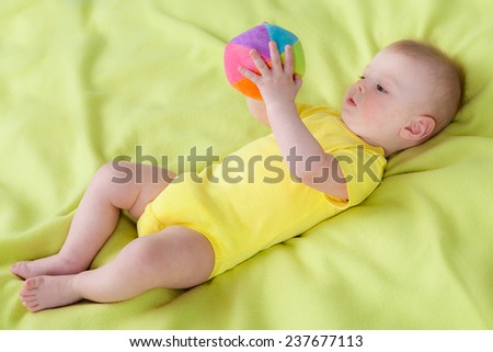 Little boy holding soft ball in his hads - stock photo