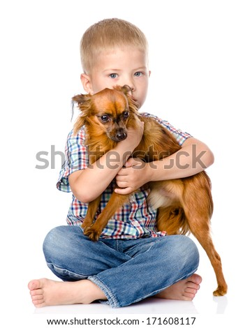 little boy hugging a dog. isolated on white background - stock photo