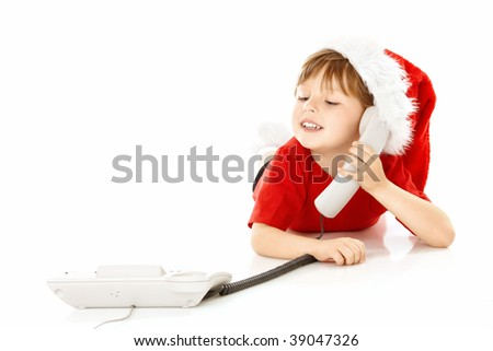 Little boy in a cap of santa calls by phone, isolated - stock photo