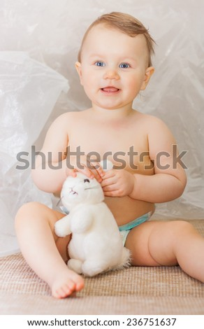 little boy in a nappy and blue eyes - stock photo