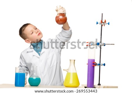 Little boy in a white coat as chemist doing experiment with multicolored chemical fluid in the laboratory isolated on white background - stock photo