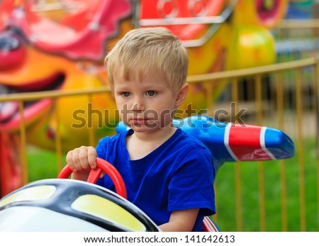 little boy in amusement park - stock photo