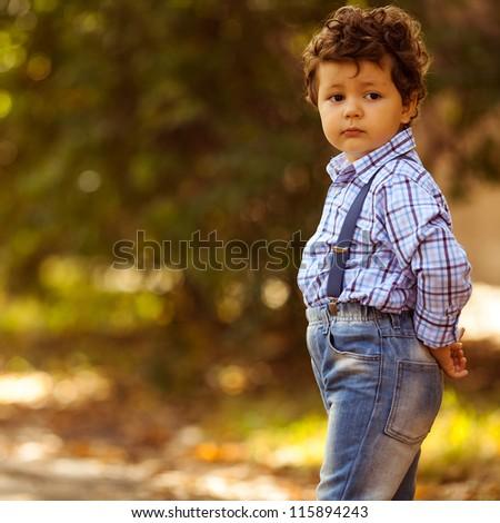 little boy in autumn park - stock photo