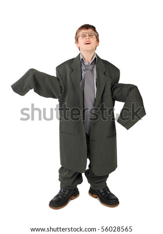 little boy in big grey man's suit, boots and glasses floor isolated on white background - stock photo
