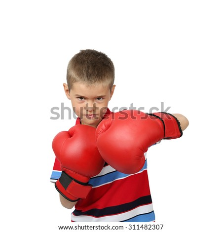 Little boy in boxing gloves with harsh facial expression isolated on square white background - stock photo