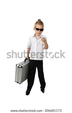 Little boy in business suit and sunglasses with briefcase in hand stays isolated on white background - stock photo