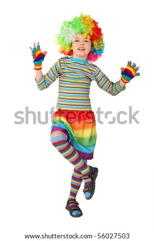 little boy in clown dress standing on one leg isolated on white background - stock photo