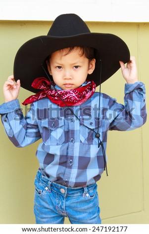 little boy in cowboy suit - stock photo