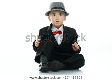 Little boy in hat and black suit isolated on white background  - stock photo