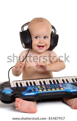 Little boy in headphones on the white background - stock photo