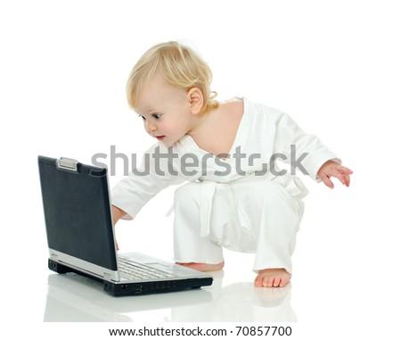 little boy in kimono about laptop on white background - stock photo