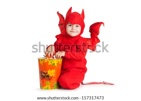 little boy in red devil costume sitting near big bucket over white background - stock photo