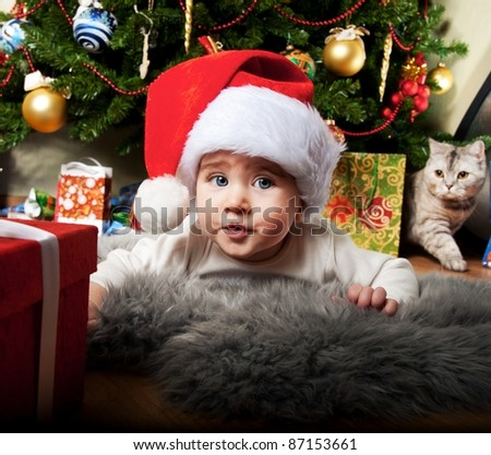 Little boy in Santa Claus hat. - stock photo