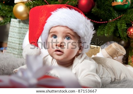 Little boy in Santa Claus hat. - stock photo