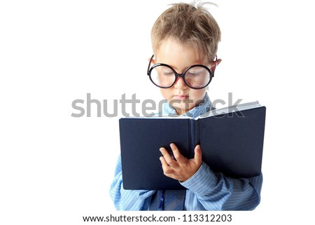 Little boy in spectacles and suit looking to his diary. Isolated over white background. - stock photo