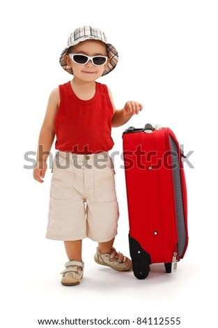 Little boy in sunglasses and hat, standing near luggage, ready for summer vacation - stock photo