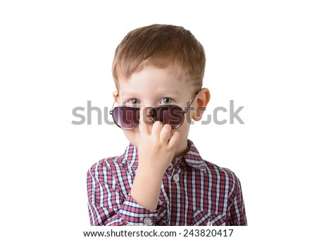 little boy in sunglasses on a white background closeup - stock photo