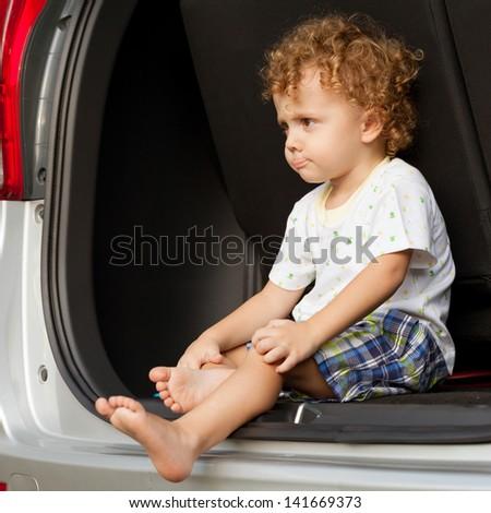 little boy in the car - stock photo
