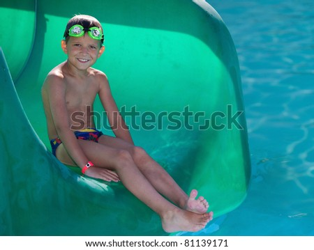 Little boy in the swimming pool - stock photo